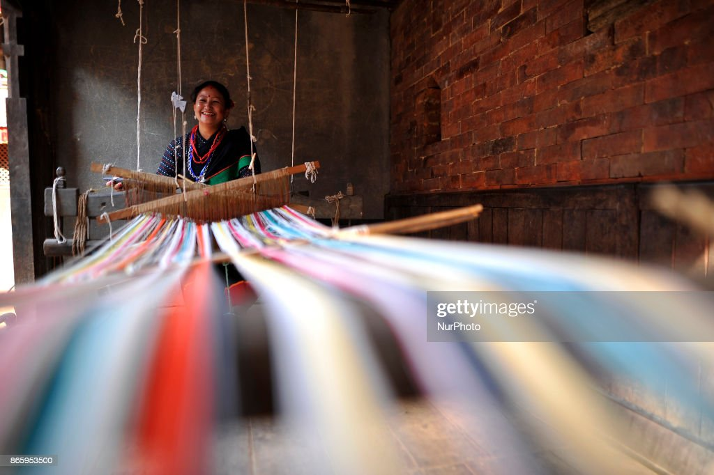 A woman in a traditional attire weaving traditional fabrics during inauguration ceremony of Jyapu Museum on the occasion of 72nd United Nations Day in Chyasal, Lalitpur, Nepal on Tuesday, October 24, 2017.