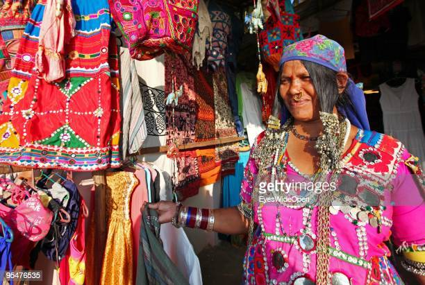 Woman in a traditional dress from an indian hill tribe is selling clothes to tourists at Varkala on December 20 2009 in Varkala near Trivandrum...