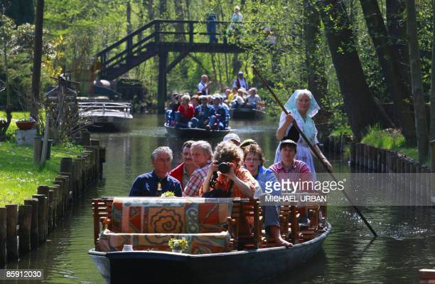 Woman in a traditional dress of the eastern German Spreewald region directs a barge through a small canal on Easter Saturday, April 11, 2009 near...
