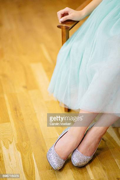 Woman in a tulle skirt and glitter high heels