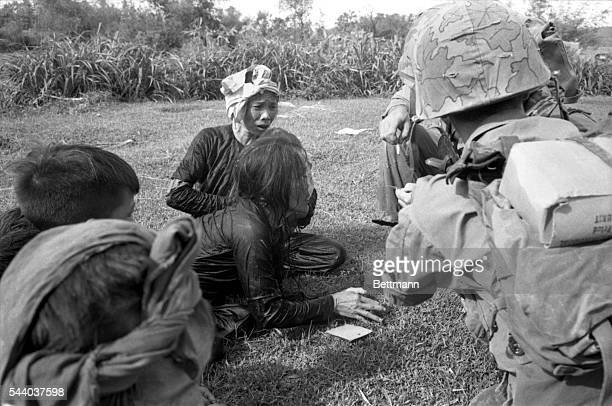 "A woman in a village north of Qui Nhon suspected of being a Viet Cong by the US Marines who made a 'Sweep"" operation in the area shows her..."