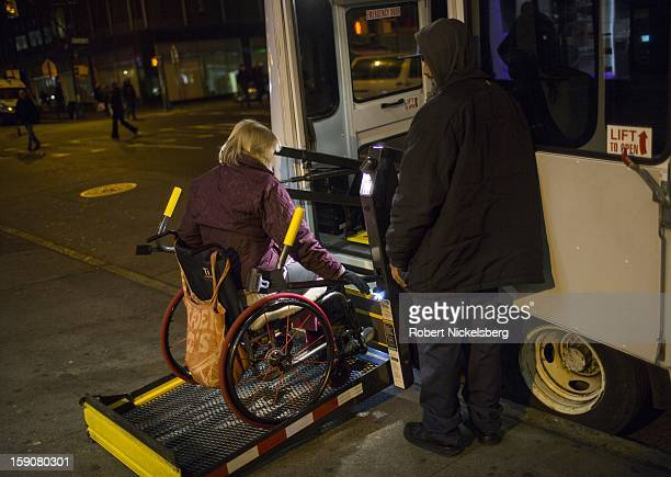 A woman in a wheel chair uses a special ramp January 5 2013 to board a bus in the Brooklyn borough of New York