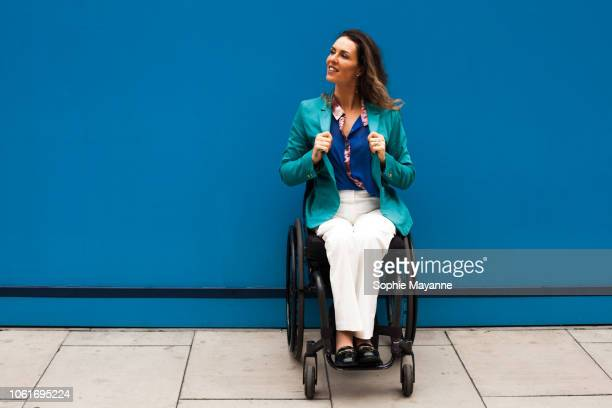 A woman in a wheelchair looking over her shoulder