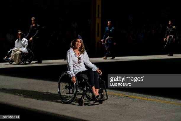 A woman in a wheelchair models a creation by Colombian designer Guio Di Colombia during the Walkway Inclusion fashion show in Cali Colombia on...