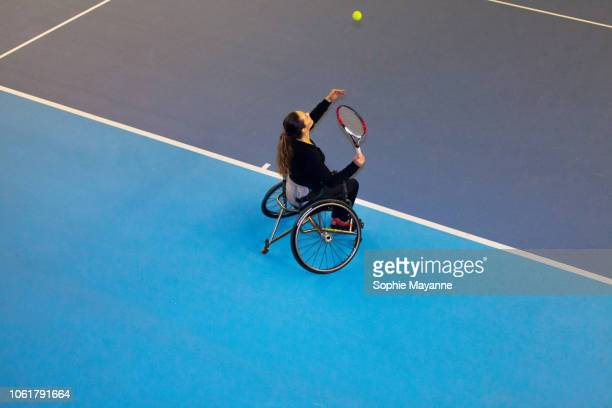 a woman in a wheelchair playing tennis - disabilitycollection stock pictures, royalty-free photos & images