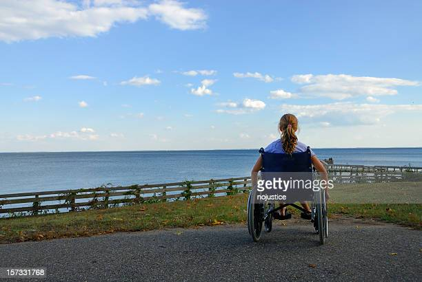 A woman in a whelk chair dreaming she could swim