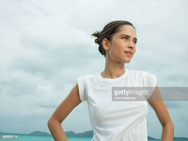 woman in a white tee at the beach - white shirt stock pictures, royalty-free photos & images