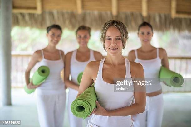 Woman in a yoga class with a group of people
