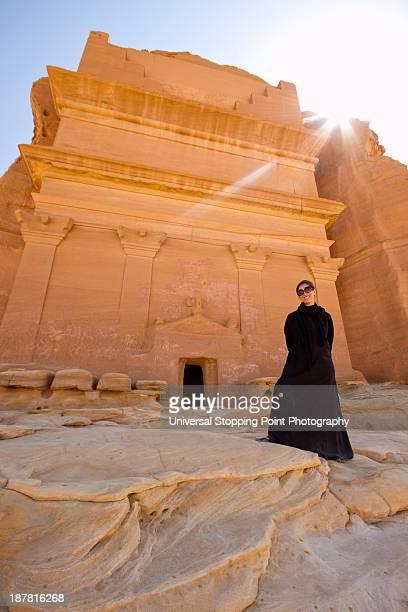woman in abaya at madain saleh - mada'in saleh stock pictures, royalty-free photos & images