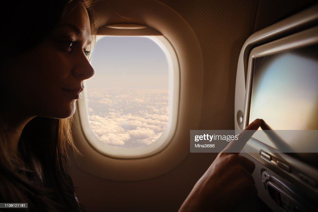 Woman in airplane : Stock Photo