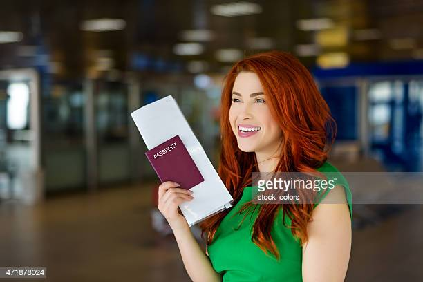 woman in airport with her passaport