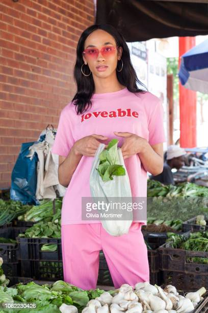 Woman in all pink shopping for vegetables