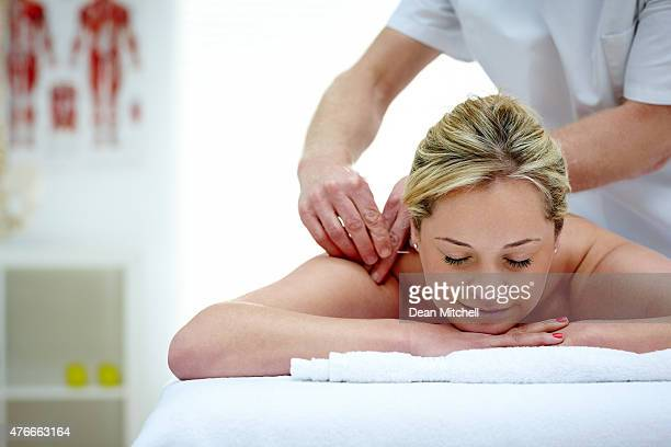 Woman in an acupuncture therapy at spa