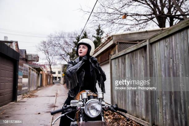 woman in an alley way with her motorcycle - のりものに乗る ストックフォトと画像