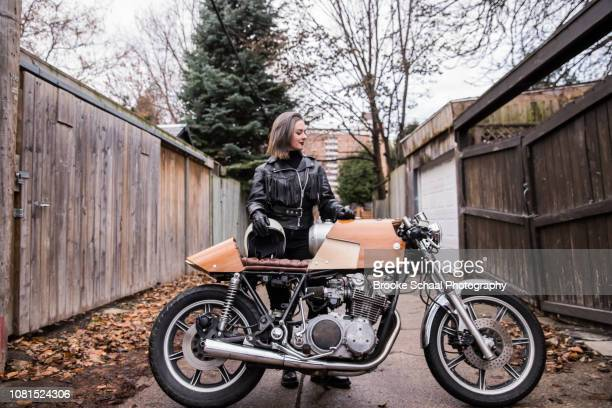 woman in an alley way with her motorcycle - showus stock pictures, royalty-free photos & images