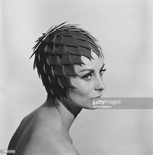 A woman in an elaborate swimming cap circa 1963