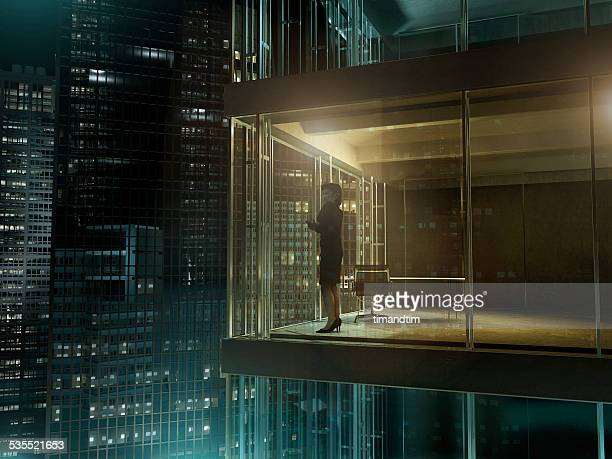 Woman in an office by night