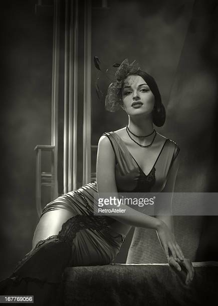Woman in an old Hollywood film noir glamour style photo