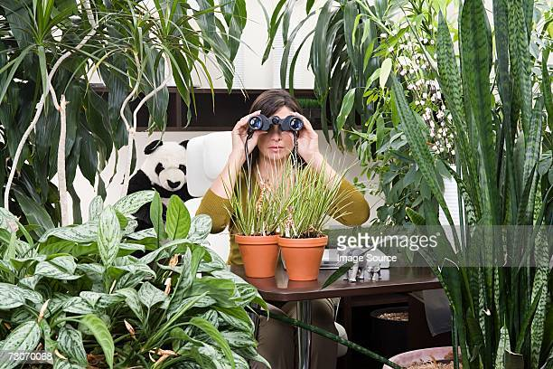 Woman in an overgrown office