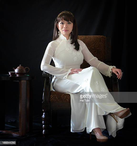 Woman in Ao Dai Trang Vietnamese Traditional Dress