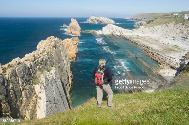 a woman in arnía beach- cantabrian sea- liencres -santander- spain - cantabria fotografías e imágenes de stock