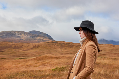 Woman in autumnal landscape - gettyimageskorea