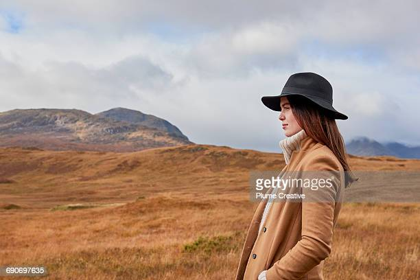 woman in autumnal landscape - coat stock pictures, royalty-free photos & images