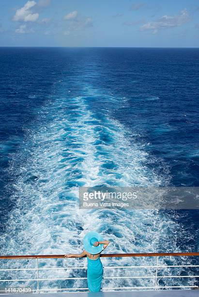 woman in awe of the ocean view on a cruise ship - crociera foto e immagini stock