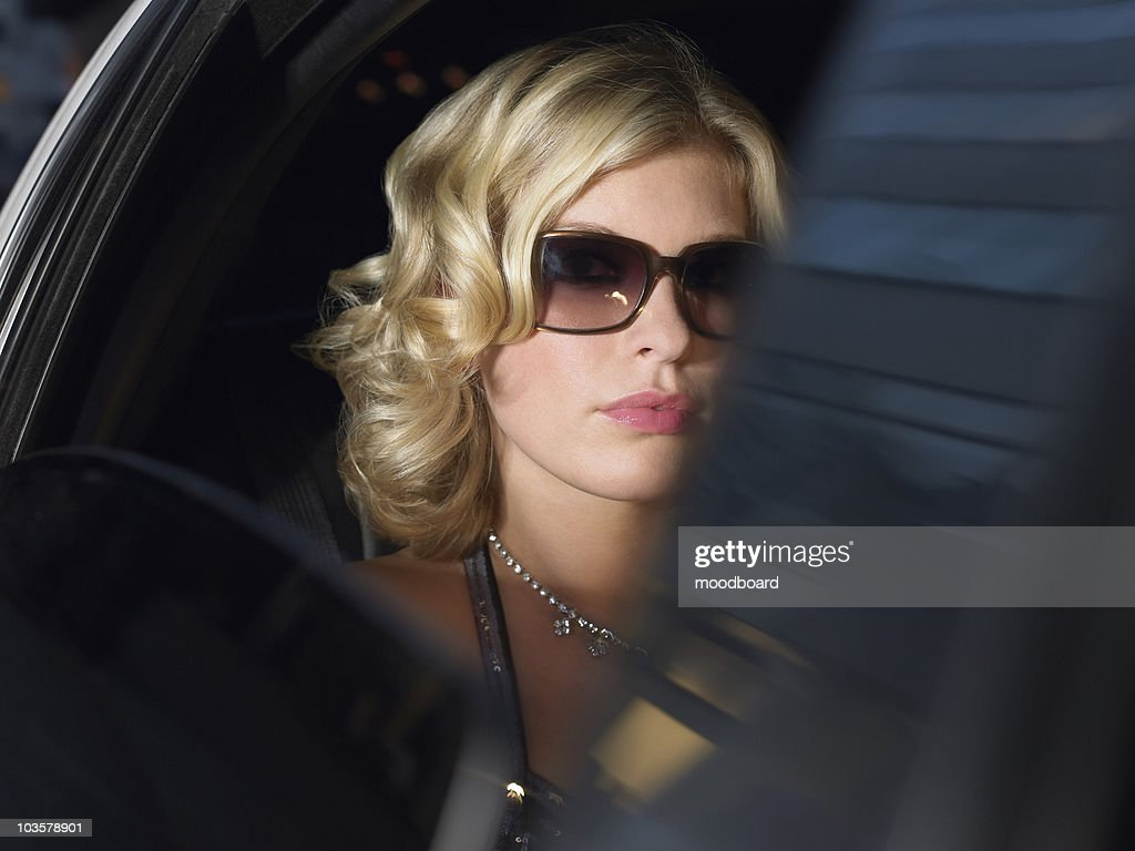 Woman in back of limousine
