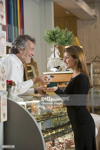 woman in bakery - candy samples stock pictures, royalty-free photos & images