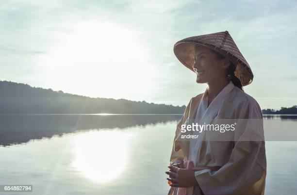 Woman in Bali at sunrise wearing traditional clothes