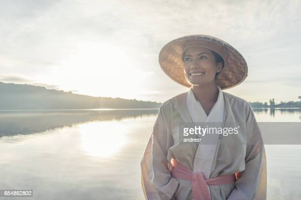 Woman in Bali at sunrise with traditional clothes