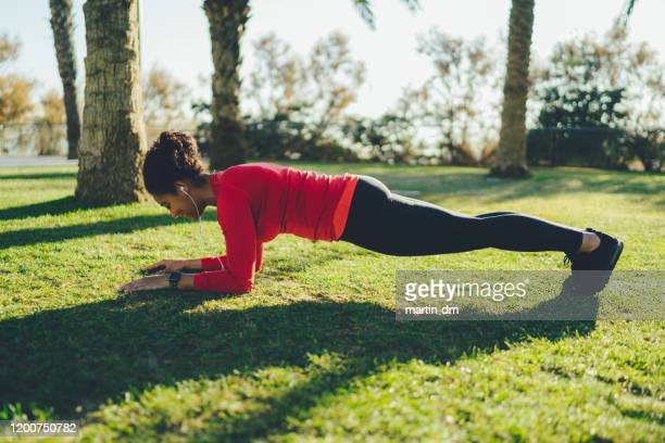 woman in barcelona sports training - plank position stock pictures, royalty-free photos & images