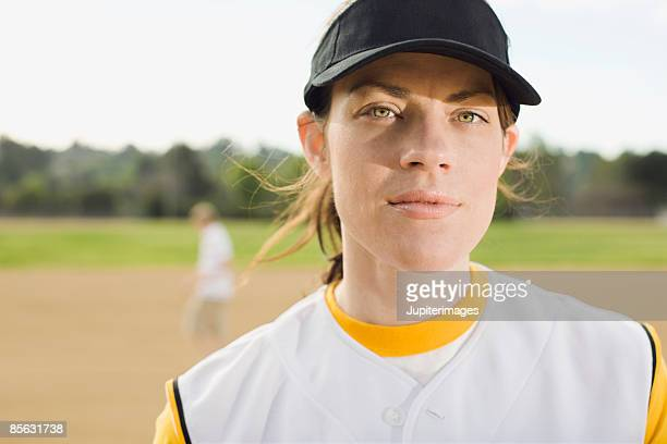 woman in baseball uniform - baseball strip stock pictures, royalty-free photos & images