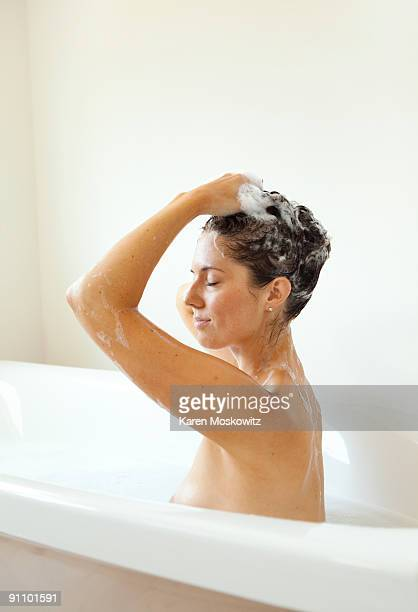 woman in bath washing hair