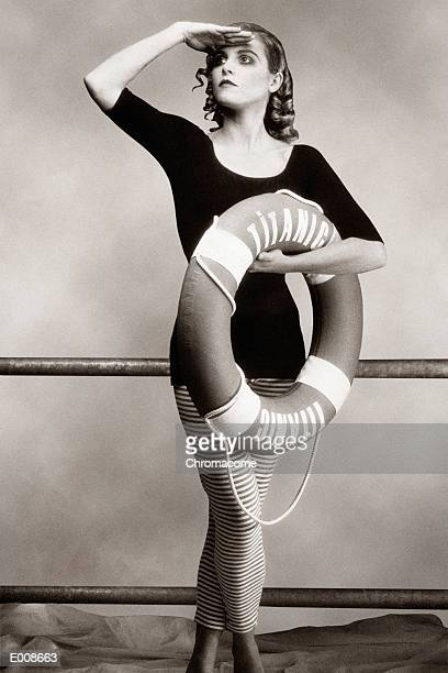 Woman in bathing costume holding life preserver