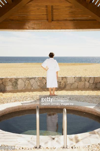 Woman in bathrobe outdoors at beach resort