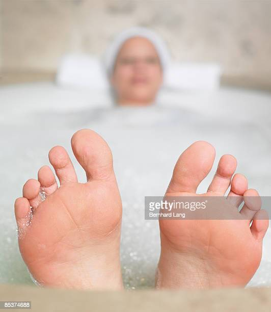 woman (36y) in bathtub - pretty toes and feet stock photos and pictures