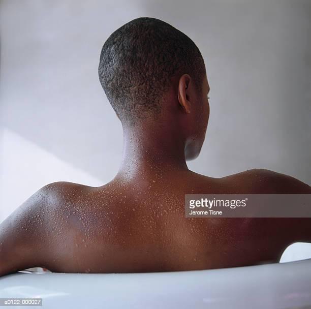 woman in bathtub - negra desnuda fotografías e imágenes de stock