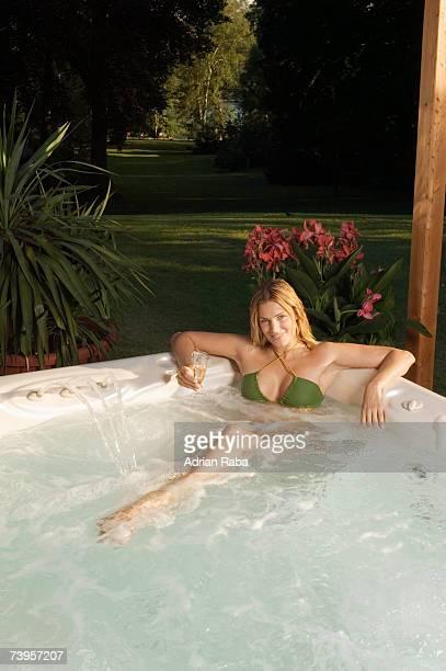 woman in bathtub, smiling, portrait - verführerische frau stock-fotos und bilder