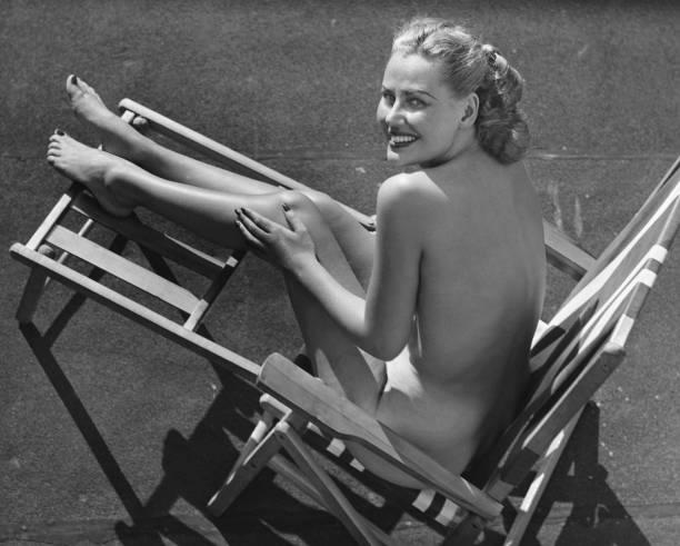 Woman in beach chair.