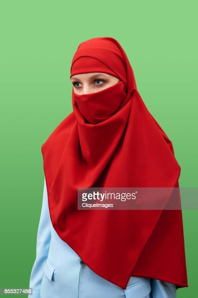 woman in beautiful red niqab - cliqueimages stock pictures, royalty-free photos & images