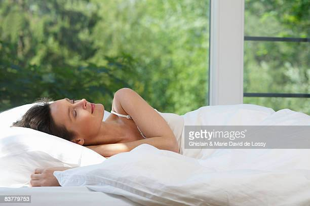 Woman in bed, in the morning