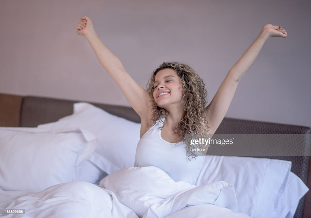 Woman in bed waking up in the morning : Stock Photo
