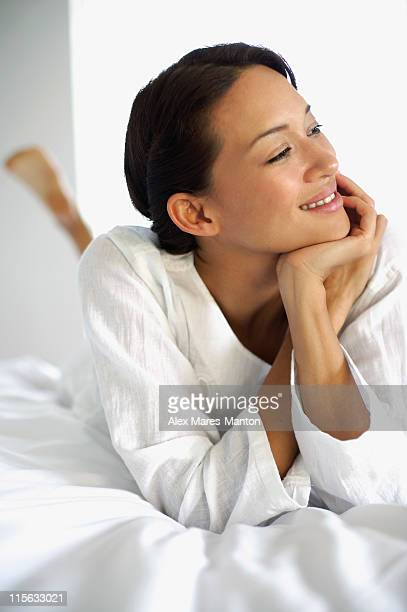 woman in bed, white robe