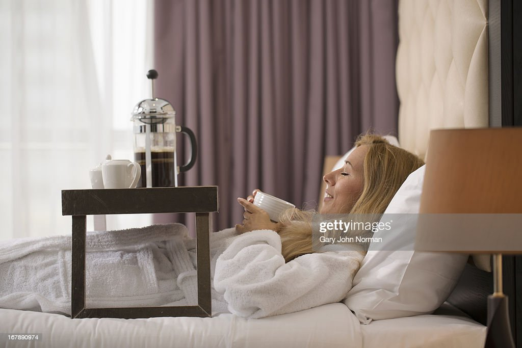 woman in bed with breakfast tray : Stock Photo