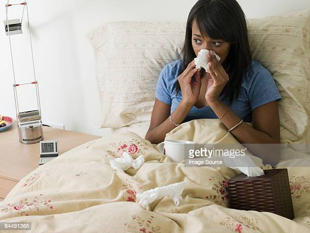 Woman in bed with cold