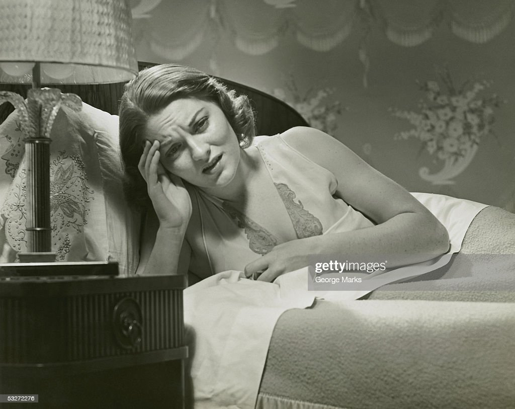 Woman in bed with headache : Stock Photo