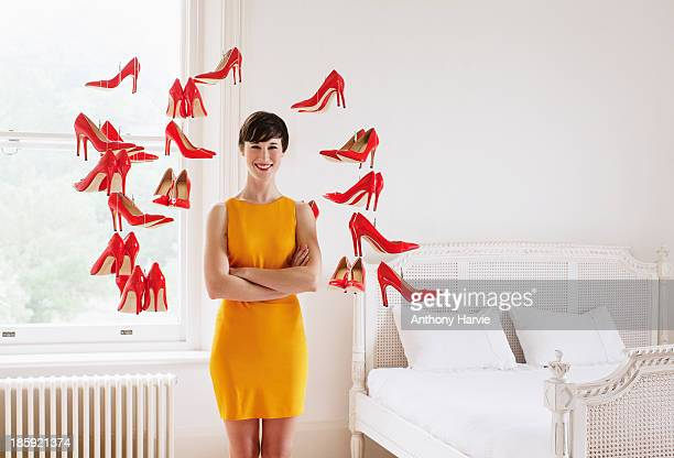 Woman in bedroom with hanging red shoes