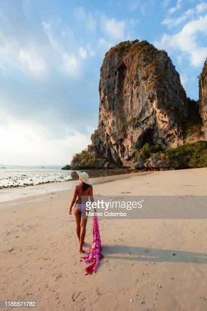 woman in bikini at phra nang beach, railay, krabi, thailand - railay strand stock-fotos und bilder